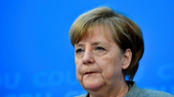 Attentat de Berlin: critiquée, Merkel a reçu les proches de victimes
