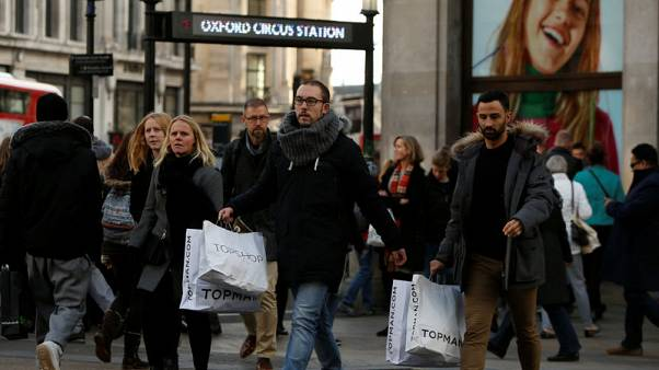 Pinched UK consumers raise spending at weakest pace since 2012