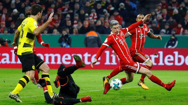 Bayern edge past holders Dortmund into German Cup quarters