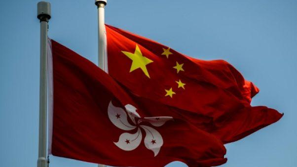 """Hong Kong: des opposants interdits d'entrée dénoncent une """"liste noire"""" de Pékin"""