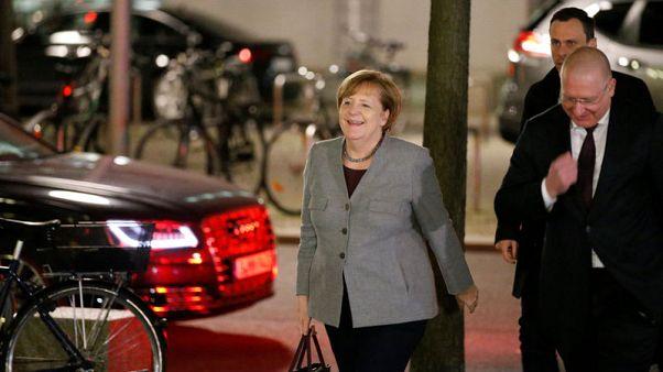 Merkel's conservatives keen, but SPD still coy on German government talks