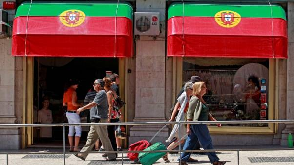 Portugal, once in EU bailout, sees budget deficit almost disappear