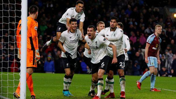 Klavan header gives Liverpool dramatic late win