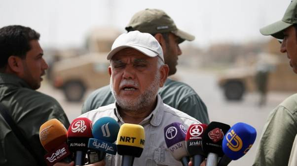 Iraqi Shi'ite paramilitary chief seeks to put troops under national army