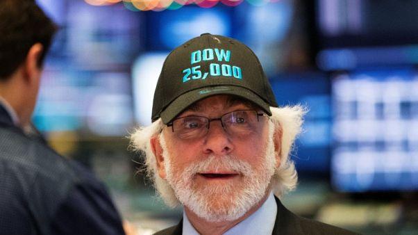 World stocks hit records, euro near three-year high
