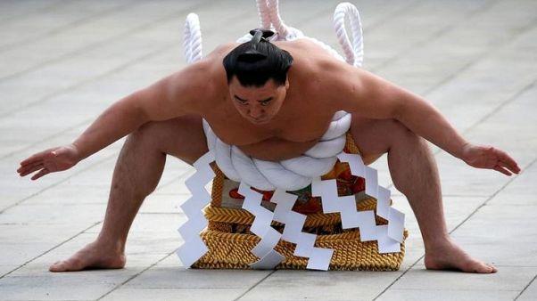 Former yokozuna Harumafuji fined for junior wrestler assault