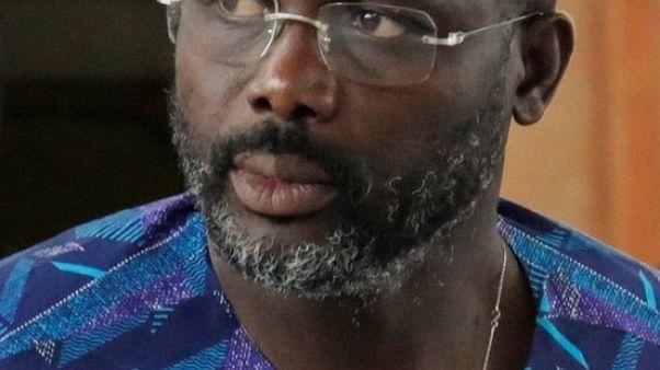 """نجم كرة القدم السابق """"الملك جورج"""" ويا يفوز برئاسة ليبيريا"""