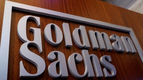 Goldman to take one-time $5 billion hit to profit from new tax law