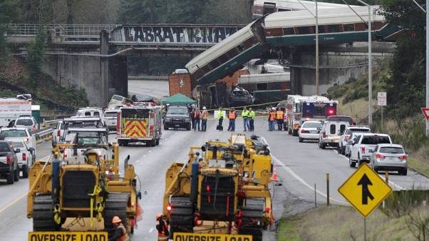 Workers clearing wreckage of deadly Washington state train crash