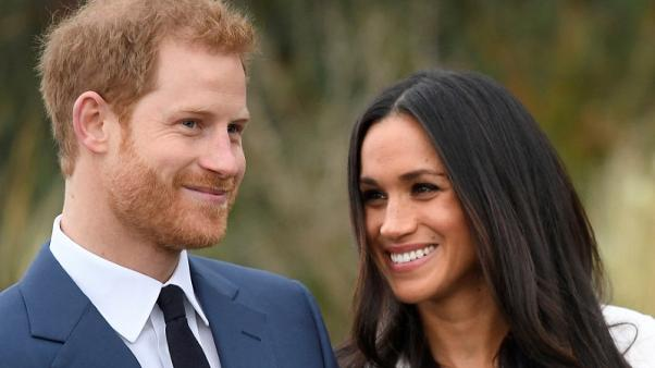 FILE PHOTO: Britain's Prince Harry poses with Meghan Markle in the Sunken Garden of Kensington Palace in London, Britain, November 27, 2017. REUTERS/Toby Melville/File Photo