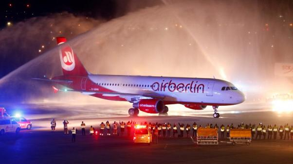 FILE PHOTO - Flight AB6210, the last by insolvent carrier Air Berlin, arrives at the Tegel airport in Berlin, Germany, October 27, 2017. REUTERS/Hannibal Hanschke