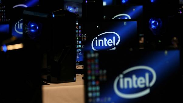 FILE PHOTO - The Intel logo is displayed on computer screens at SIGGRAPH 2017 in Los Angeles, California, U.S. July 31, 2017.  REUTERS/Mike Blake