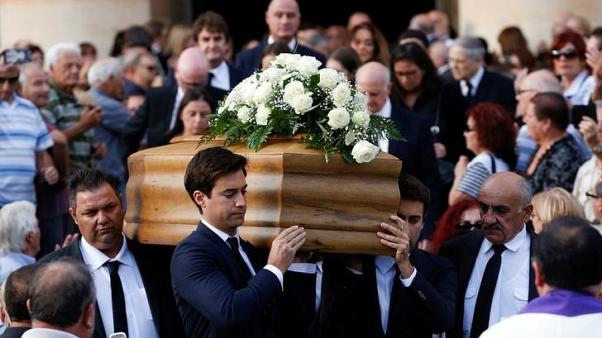 Journalist Daphne Caruana Galizia's sons Matthew and Paul carry the coffin of their mother, who was murdered in a car bomb attack, as they leave from the Rotunda Parish Church in Mosta, Malta, November 3, 2017. REUTERS/Alessandro Bianchi