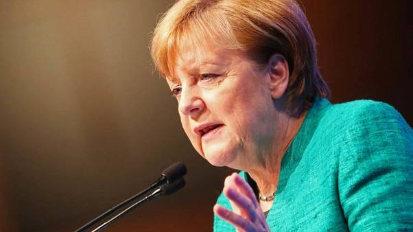Putin and Merkel agree to try to return Russian observers to east Ukraine