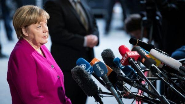 Merkel affiche sa confiance pour sortir l'Allemagne de l'impasse