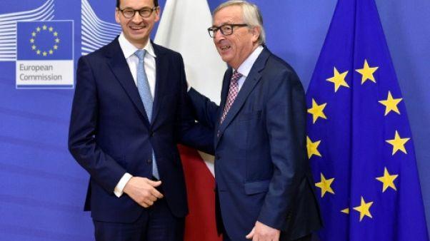 Pologne: Morawiecki limoge deux ministres controversés avant de voir Juncker