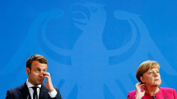 Merkel, Macron say no alternative to peaceful settlement in eastern Ukraine