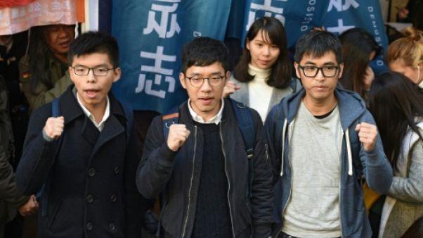 Hong Kong: trois militants prodémocratie contestent en justice leur emprisonnement