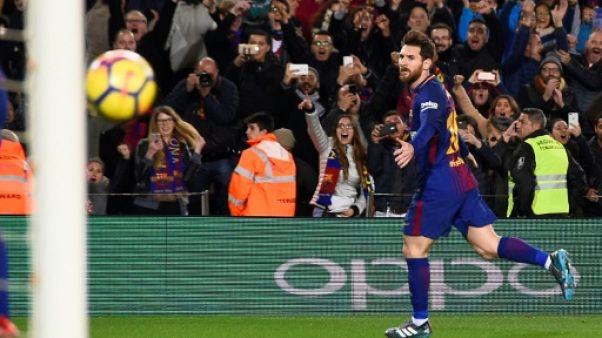 Espagne: Messi sauve un Barça controversé, l'Atlético rebondit