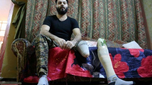 En Irak, handicap et pauvreté après les blessures subies au front