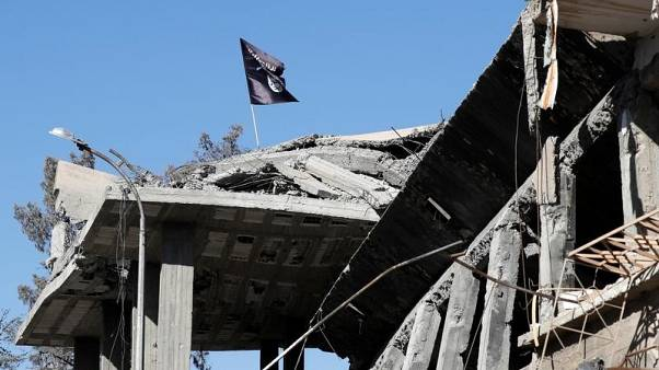 U.S. sanctions three people, three firms for supporting Islamic State