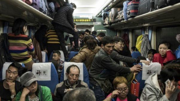 Chine: dans le train du Nouvel an, entre joie et amertume