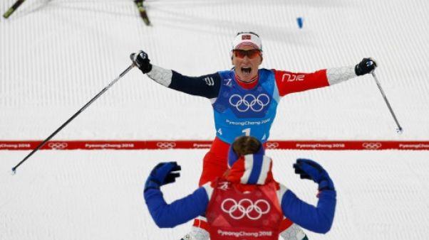 """JO-2018: """"Gull Marit"""" Björgen rejoint le patriarche Björndalen au sommet de l'Olympe"""
