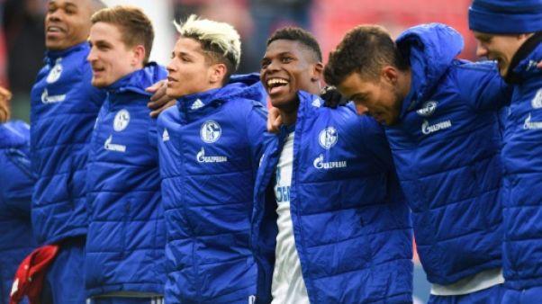Allemagne: Schalke gagne à Leverkusen et pose un pied sur le podium