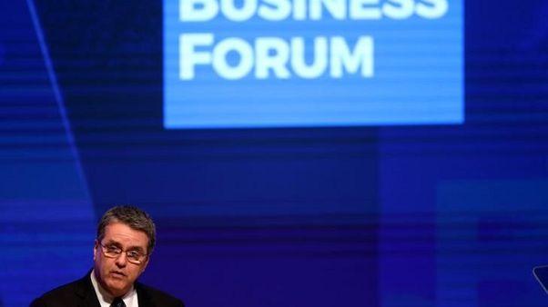 رئيس منظمة التجارة العالمية يوجه تحذيرا نادرا من حرب تجارية