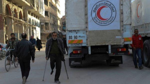 Syrie: une livraison d'aides écourtée dans la Ghouta, où le régime progresse rapidement