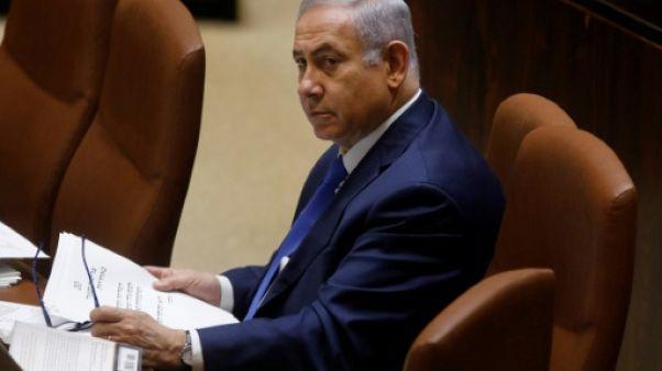 Israël: la coalition gouvernementale de Netanyahu survit, pour le moment