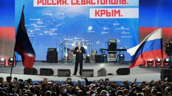 """En Crimée, Poutine salue le rétablissement d'une """"justice historique"""""""