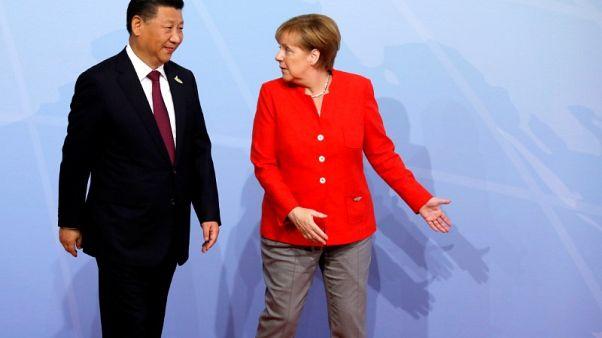 اتفاق ميركل وشي على مناقشة قضية إنتاج الصلب في إطار مجموعة العشرين