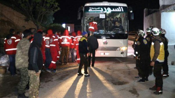 Syrie: des rebelles évacués de la Ghouta arrivent à Idleb, selon l'OSDH