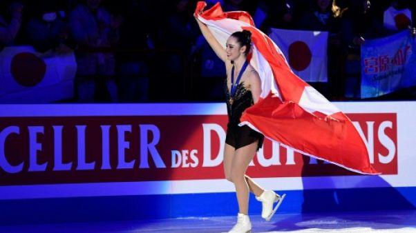 Mondiaux de patinage: premier titre pour Osmond, Zagitova s'effondre