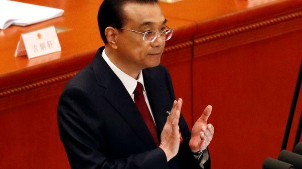 رئيس الوزراء الصيني يدعو للتفاوض لحل النزاعات التجارية