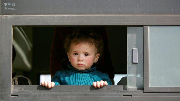 آلاف آخرون يغادرون بموجب اتفاق لتسليم الغوطة الشرقية