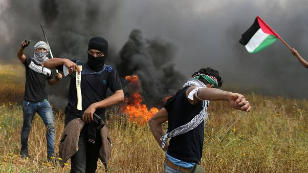 """مسعفون: الجيش الإسرائيلي يقتل 12 فلسطينيا في احتجاجات """"يوم الأرض"""" في غزة"""