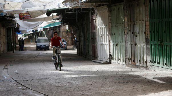 إضراب شامل في الأراضي الفلسطينية بعد سقوط قتلى في مظاهرات يوم الأرض