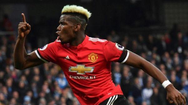 Angleterre: Manchester United renverse Manchester City 3-2 et lui retarde son sacre