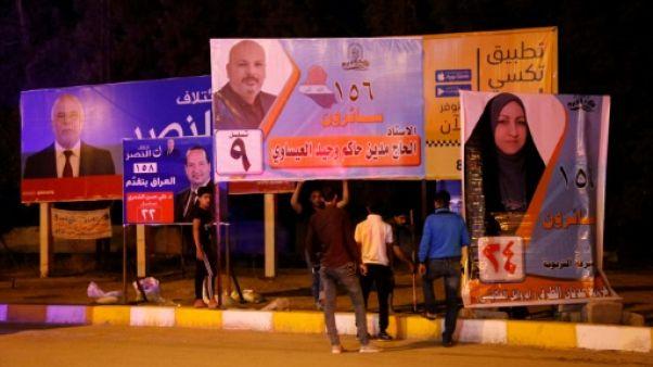"""Irak/élections: Remplacer les posters des """"martyrs"""" par ceux des candidats suscite la polémique"""