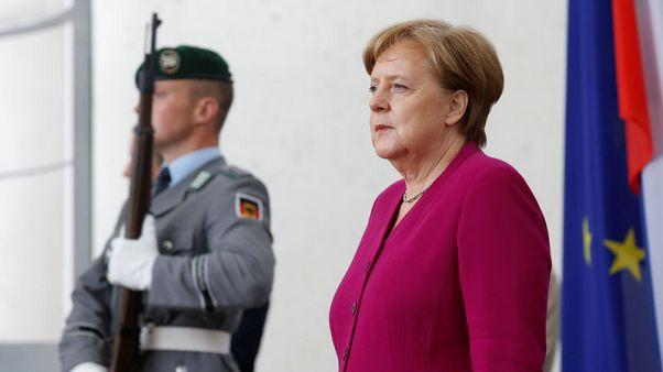 ميركل: يجب أن تحصل أوروبا على إعفاء طويل الأجل من الرسوم الجمركية الأمريكية