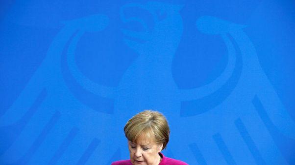 ميركل: ينبغي توسيع إطار التفاوض بشأن اتفاق إيران النووي