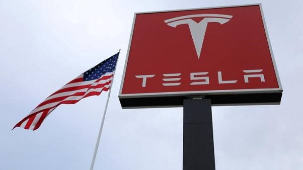 ISS sides against two Tesla directors, backs split of Musk's roles