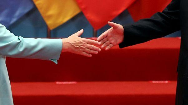 Trump trade threat looms large as Merkel heads to China