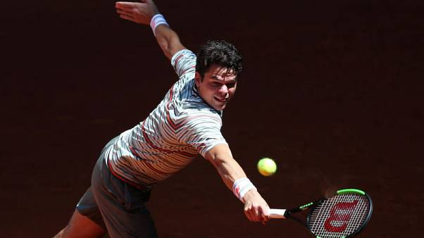 Raonic pulls out of French Open with knee injury