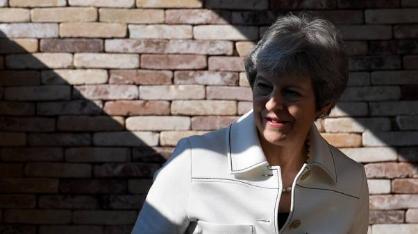 Britain's argument is with Russian government, not people - May's spokesman