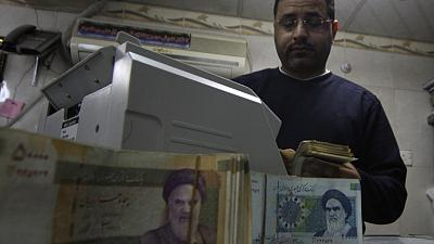 In first move since FX crackdown, Iran lowers rial vs. dollar