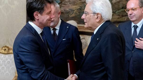 Markets breathe easier as Italy government sworn in