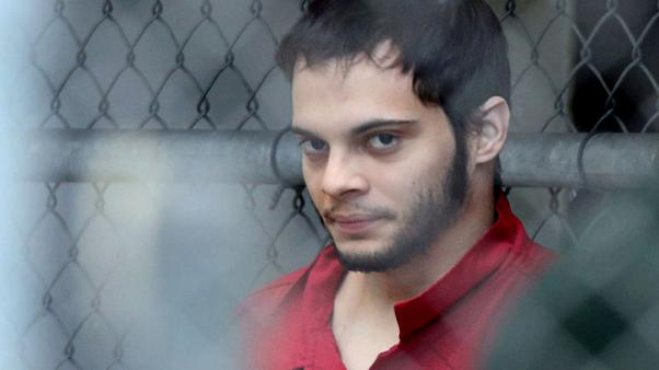 U.S. veteran pleads guilty to airport killings to avoid death penalty